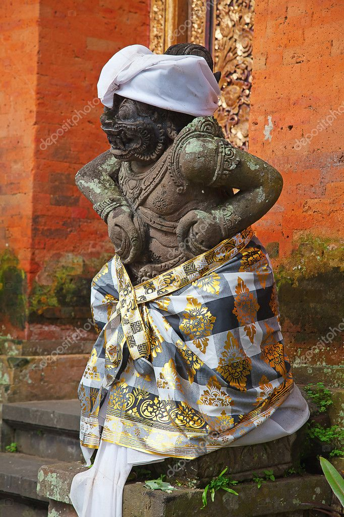 Traditional balinese sculpture near entrance to the temple  Stock Photo #5897661