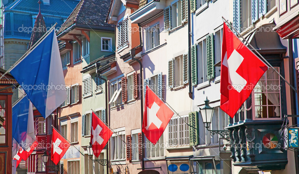Ancient street Augustinergasse in Zurich decorated with swiss flags — Stock Photo #6534975