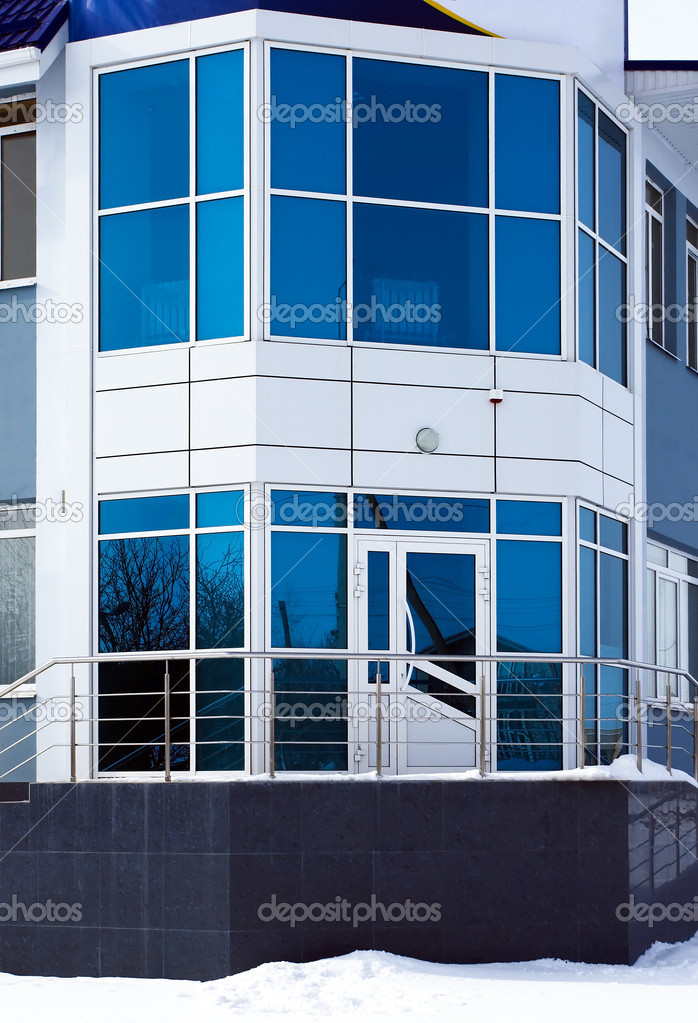 Blue galss facade off small office building — Stock Photo #5433725
