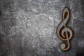 Rusty clef on grunge background — Stock Photo