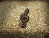 Rusty clef on grunge background — Stock Photo
