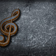 Rusty clef on grunge background — Stock Photo #5591661