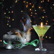 Foto Stock: Green mask and candle