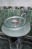 Washbasin and tap and pipes with water flow — ストック写真