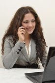 Business lady talking on the phone — Stock Photo