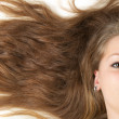 Healthy beautiful long hair closeup in motion created by wind — Stock Photo #5537627