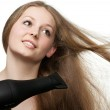 The girl with long hair does to itself a hairdress. — Stock Photo