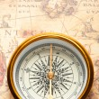 Old compass on ancient map — Stock Photo #5537852