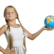 The girl holds the globe collected from puzzle in hands. Selecti — Stock Photo #5537865