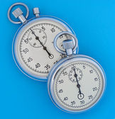 Two stopwatch on blue — Stockfoto