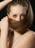 The girl closes long hair the bottom part of the person. A yashm — Stock Photo