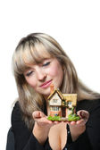 The business woman holds the small house in the hands — Stock Photo