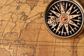 Old compass and map — Stock Photo