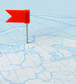 Red flag a pin on map — Stock Photo