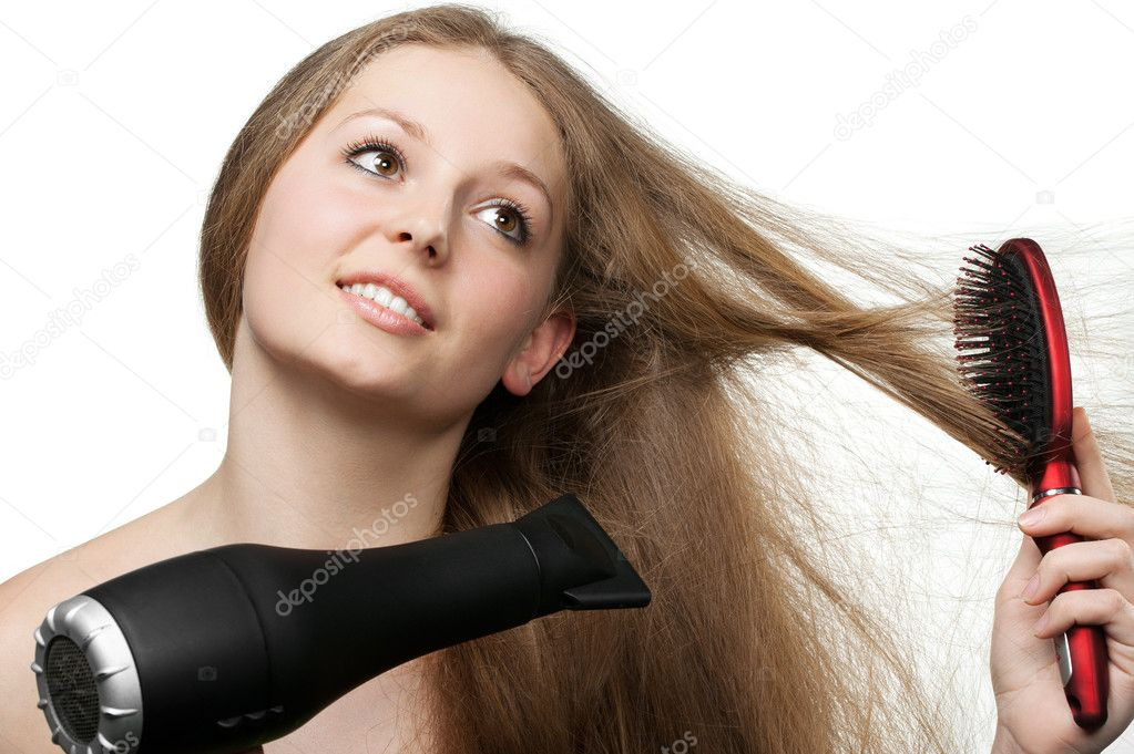 The girl with long hair does to itself a hairdress. It is isolated on a white background — Stock Photo #5537635