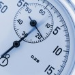 Stopwatch closeup. With a moving arrow — Stock Photo