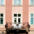 Facade of a building with a balcony. — Stock Photo