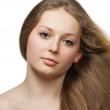 Healthy beautiful long hair closeup in motion created by wind — Stock Photo #5945097
