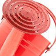 Red watering can - Stock fotografie