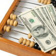 Abacus and dollars - Stock Photo