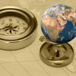 Ancient compass and earth — Stock Photo