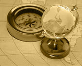 Ancient compass and globe — Stock Photo