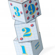 Figures on cubes - Stock Photo