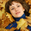Stock Photo: Girl and autumn leaves