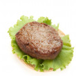 Cutlets with a leaf of salad on on bread — Stock Photo #6195049