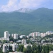 Modern city located in an environment of mountains — Stock Photo