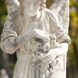 Monument to an angel on a cemetery - Stock Photo