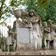 Tombstone family on a cemetery - Stock Photo