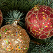 Christmas toys on branches of a fur-tree — Stockfoto