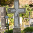 Old cross on a cemetery - Stock Photo