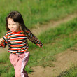 The running girl on a green field — Stock Photo