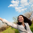 Stock Photo: Happy attractive womwith lifted hands
