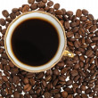 Stylish coffee cup with seed — Stock Photo