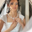 Stock Photo: Bride before mirror