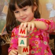The girl and word mama from cubes — Stock Photo