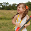 Stock Photo: The girl with a guitar
