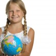 The girl holds the globe collected from puzzle in hands. Selecti — Stock Photo