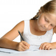 The girl writes to writing-books. The decision of lessons. — Stock Photo