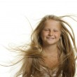 The pretty girl the blonde with flying hair — Stock Photo #6198565