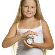 The girl holds an alarm clock in hands — Stock Photo