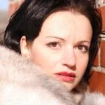 Woman in a fur coat — Stock Photo