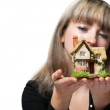 The business woman holds the small house in the hands — Stock Photo #6199577