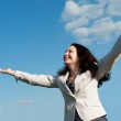 The happy attractive woman with the lifted hands — Stock Photo