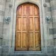 Wooden doors in ancient castle - Stock Photo
