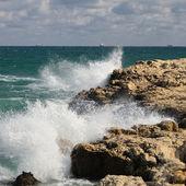 Splash of waves about coastal stones — Stock Photo