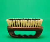 Brush for cleaning green background — Stock Photo